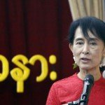 Myanmar's pro-democracy leader Aung San Suu Kyi speaks at a ceremony to mark country's National Day at National League for Democracy party's head office in Yangon